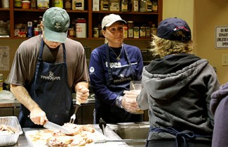 volunteers feeding the homeless