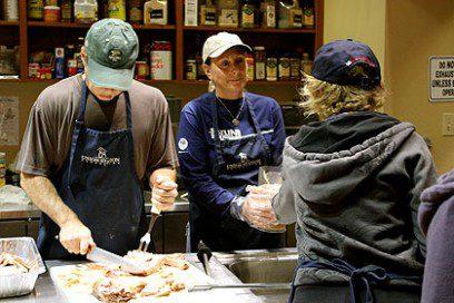 volunteers feeding the homeless